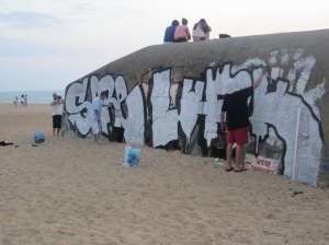 Graffiti artists working on a bunker at Labenne Ocean